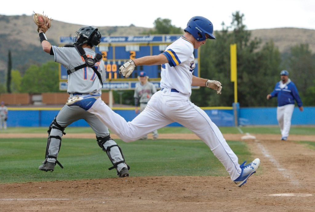 HOME BASE—Agoura High baseball left fielder Nico Della Ripa, right, scores during the Chargers' 7-6 win against Agoura on May 2 at home. Della Ripa is also a star wide receiver for the school's football team. Photos by MICHAEL COONS/Acorn Newspapers