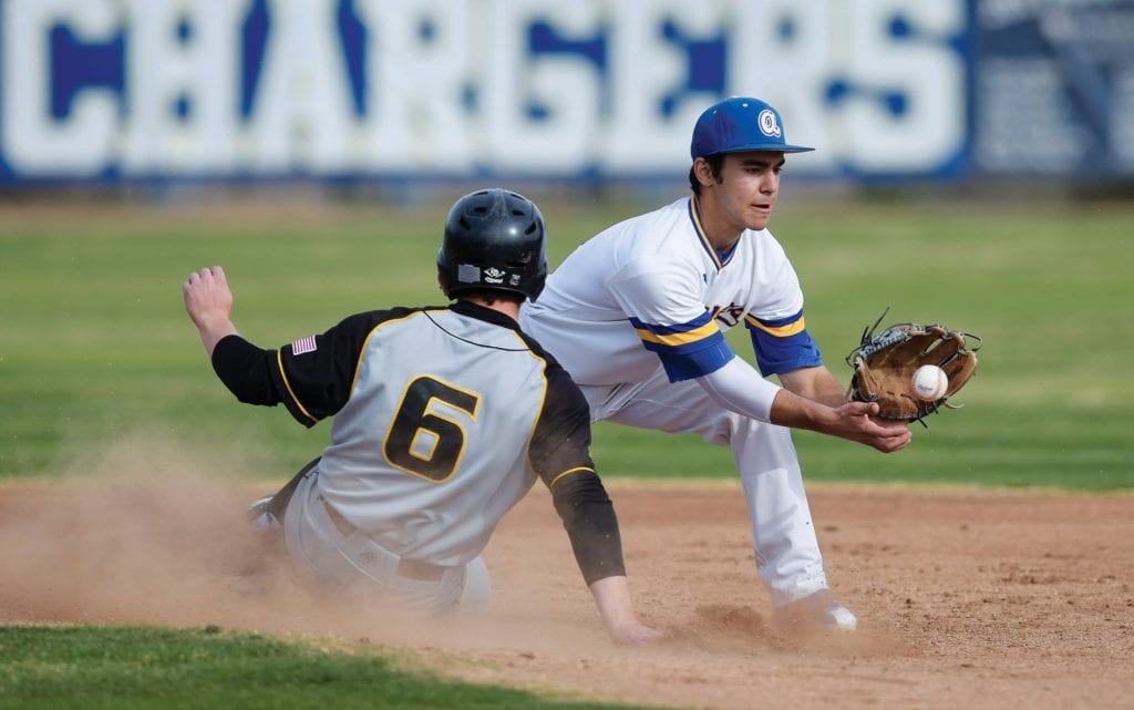 GET OUT—Agoura's Artin Biageyian, right, forces out Newbury Park's Max Flame earlier this season.
