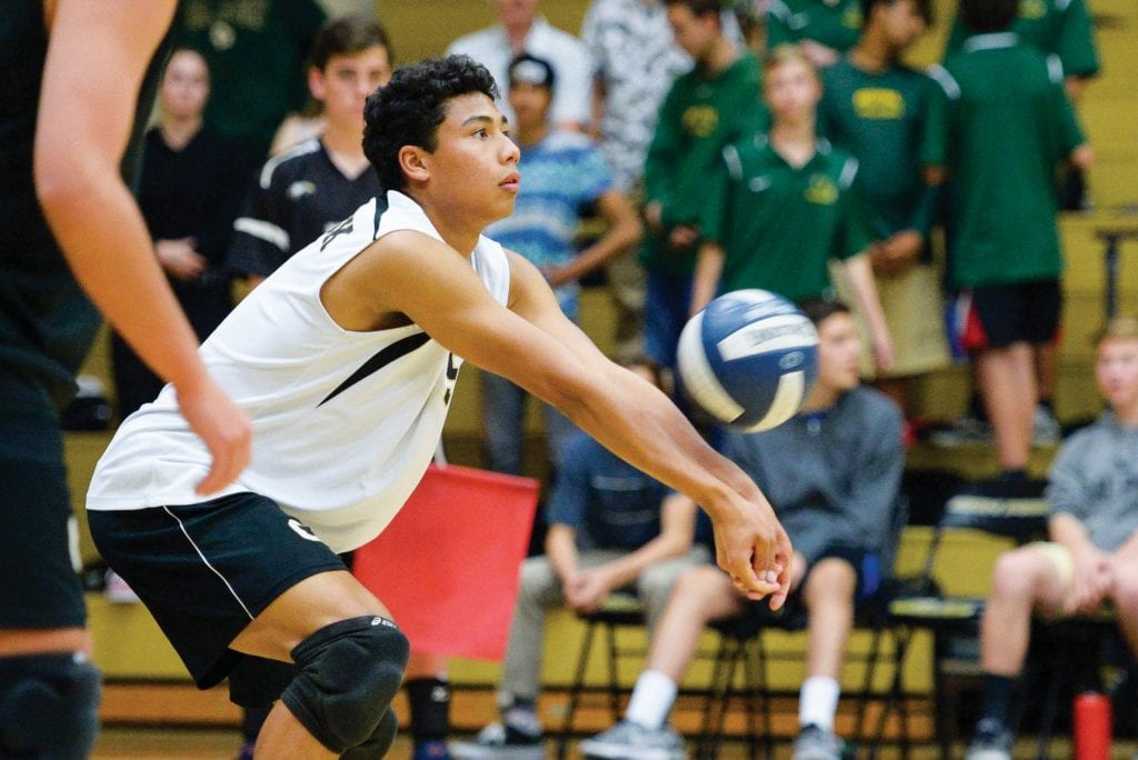 BUMP AND RUN—Oak Park High boys' volleyball junior outside hitter Kelly Majam hits the ball against Royal earlier this year. The Coastal Canyon League champ Eagles lost on Tuesday in the Division 1 playoffs. MICHAEL COONS/Acorn Newspapers