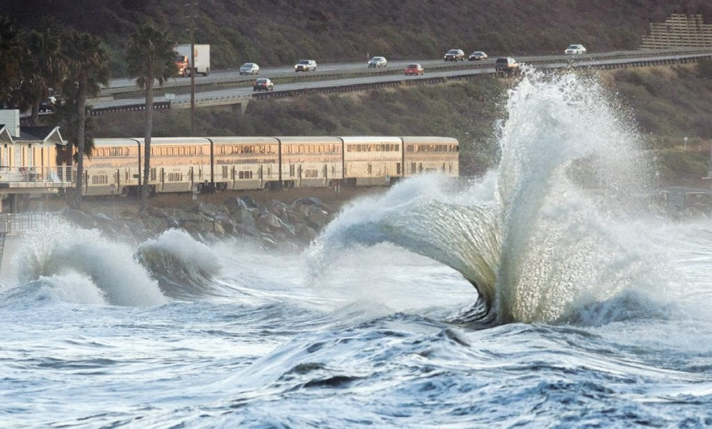 RISING RIDE—Large waves pound Mondos Beach in Ventura County. Acornfile photo