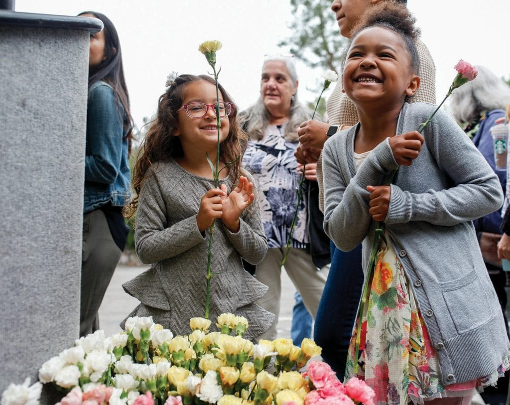 PETAL POWER—Left, Emma Camilo, 5, of Agoura Hills and Brooklyn Spencer, 6, of Woodland Hills pick outflowers during the 55th annual Mother's Day Pancake Breakfast on May 13 at Malibu Lake Mountain Club in Agoura Hills.