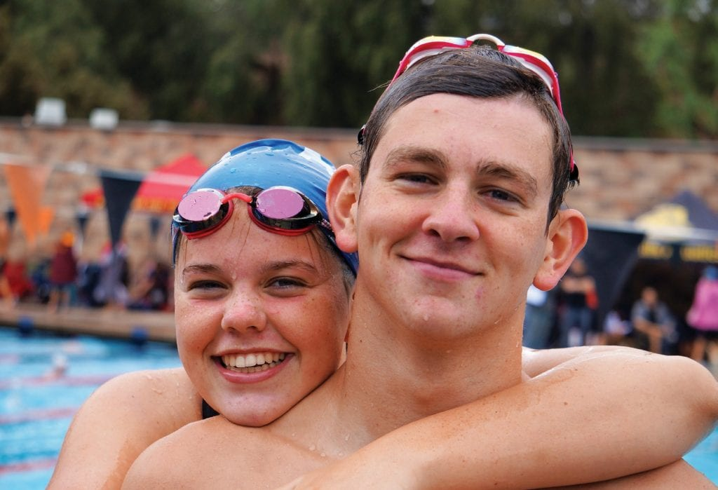 FASTER THAN LIGHTNING—Ellie Shorten, left, and her older brother Reid smashed Agoura High records at the CIF-Southern Section Swimming and Diving Championships last weekend in Riverside. Courtesy of Ellie Shorten