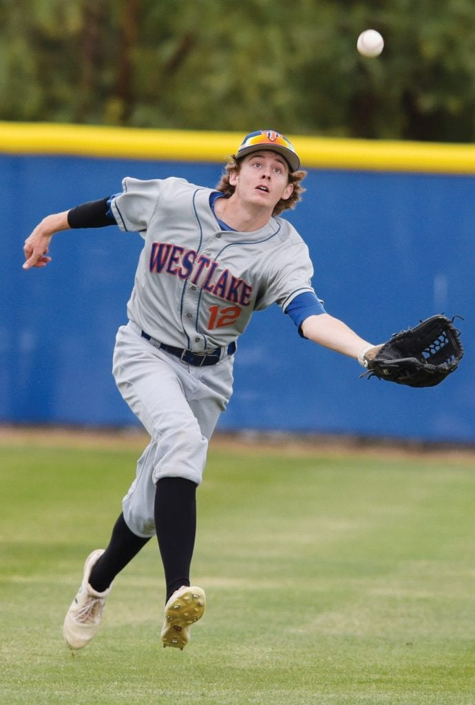 LUNGE—Westlake High center fielder Cade Kritsch goes after a pop up against Agoura on May 2. Kritsch sports a 5.0 GPA in the classroom. Photos by MICHAEL COONS/Acorn Newspapers