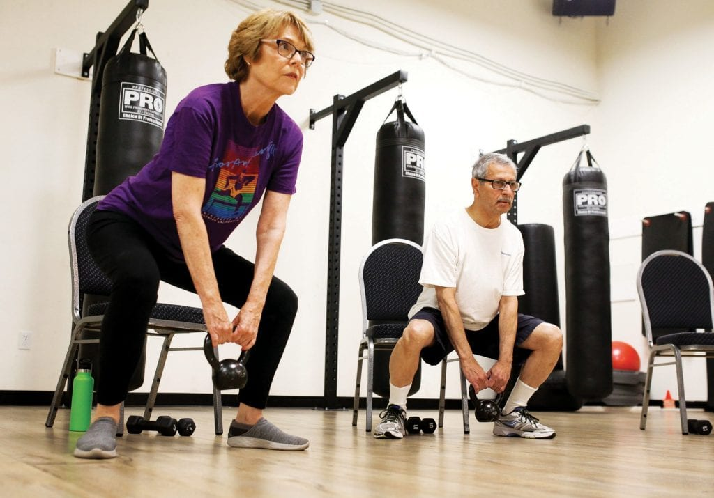 DON'T WEIGHT TO GET IN SHAPE—Cathie Loeb of West Hills participates in a seniors' class at Revolution Fitness in Agoura Hills. Eligible Medicare participants receive free workouts and gym time. BOBBY CURTIS/Acorn Newspapers