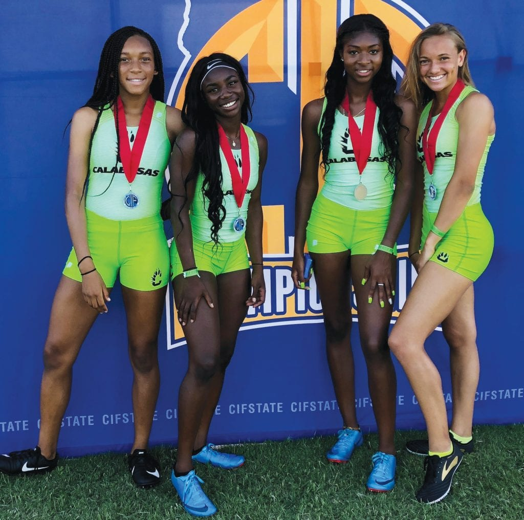 SHARP IN NEON GREEN—Calabasas High track and field standouts, from left, Mya Collins, De'Anna Nowling, Kyla Robinson-Hubbard and Kennedy Waite took silver in the girls' 4x100-meter relay in 45.91 seconds at the CIF State Track and Field Championships on June 2 at Buchanan High in Clovis. Courtesy of Calabasas athletics