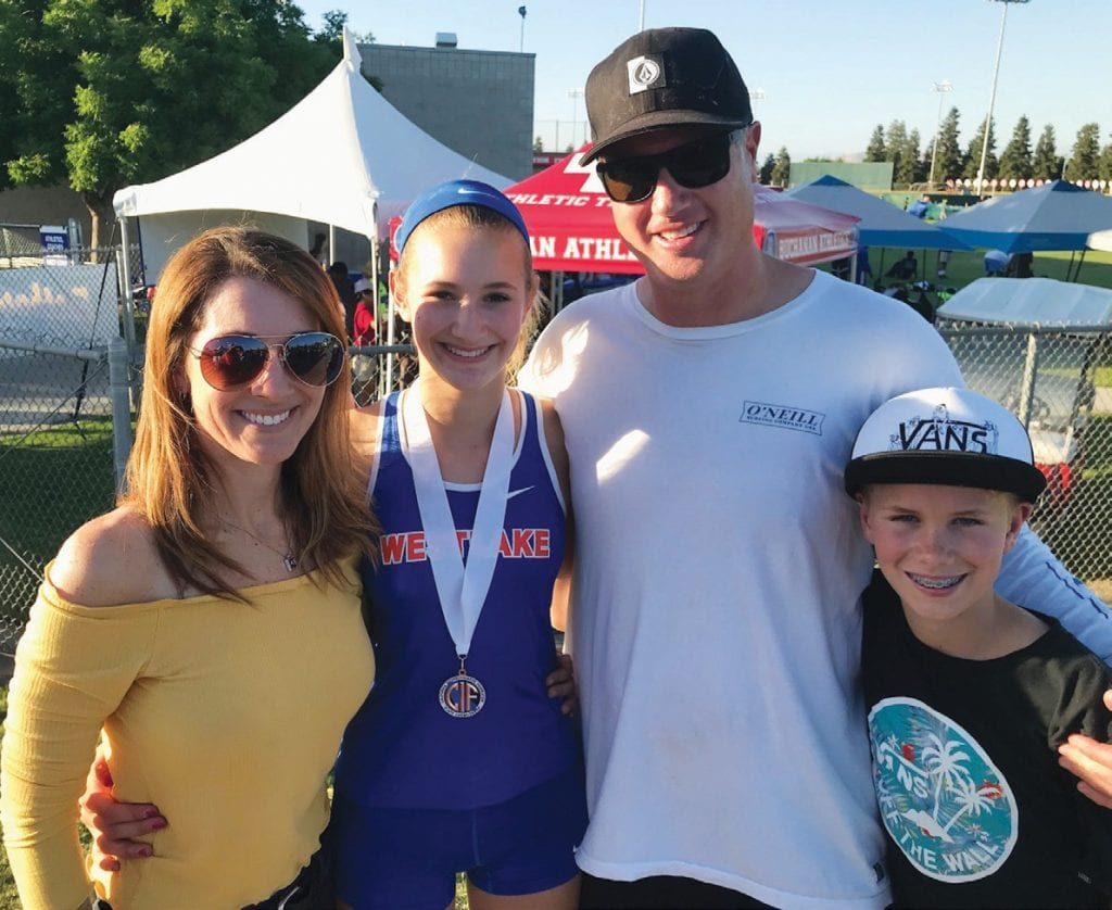SOMMERS IN SEASON—Westlake freshman Paige Sommers, second from left, is joined by her parents, Jennifer and John, and her younger brother, Cade. Paige Sommers took bronze in the pole vault at state. Courtesy of Paige Sommers
