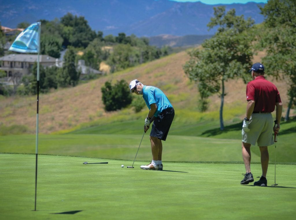 CONCENTRATION—A player lines up a putt at a previous Boys & Girls Club tournament. This year's tourney is Mon., June 11 in Moorpark. Courtesy of Dave Peloso