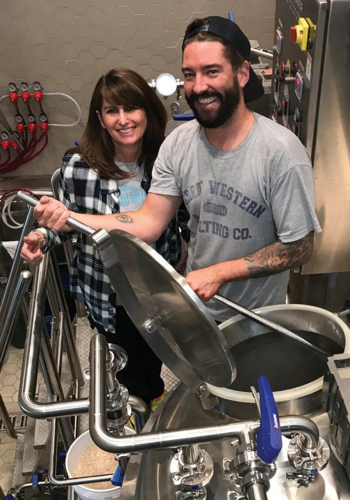 THE RIGHT RECIPE—Jodi Shapiro from Martell and Noah Regnery of Bluebird Brasserie craft a signature beer for the Brew for a Cure fundraiser. Courtesy photo