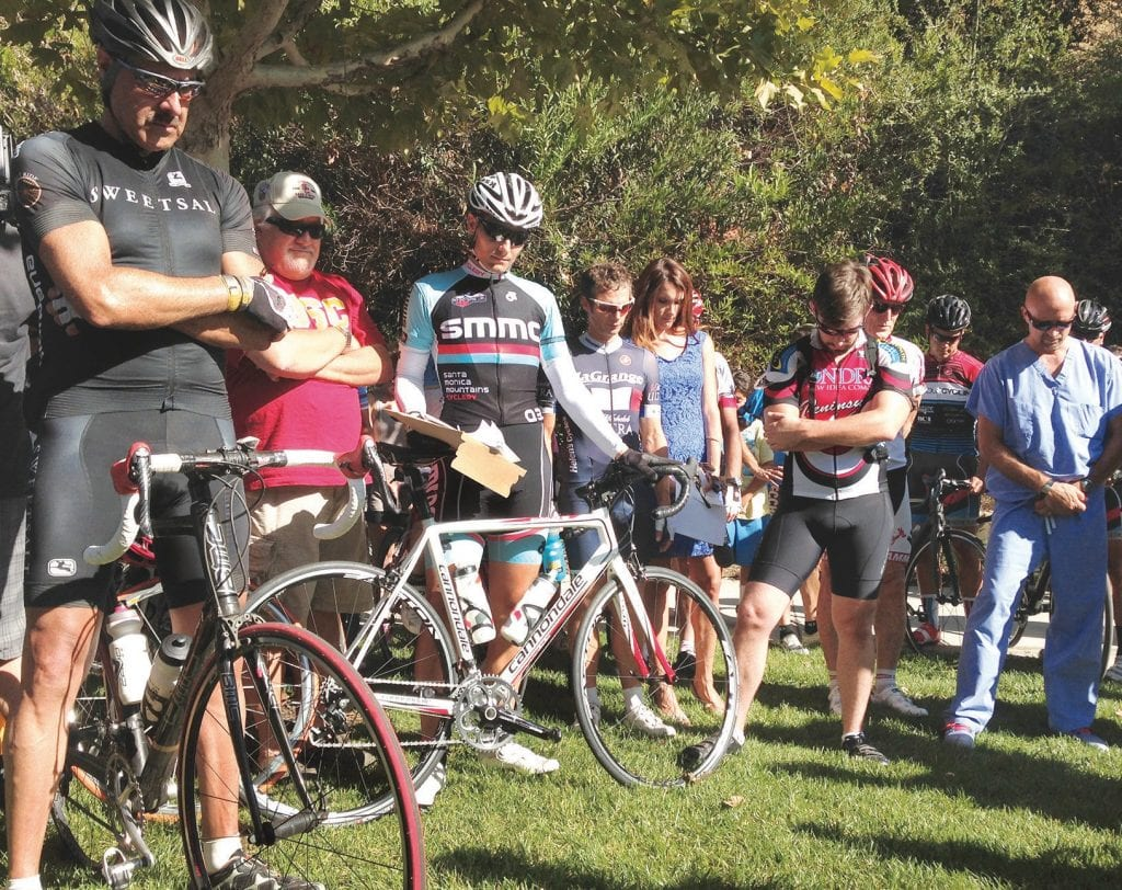 REMEMBERING—Members of a cycling coalition gathered at Mulholland Highway in 2014 to pay their respects to Milt Olin, an avid bike rider who was killed on the road by a sheriff 's patrol car. Acornfile photo