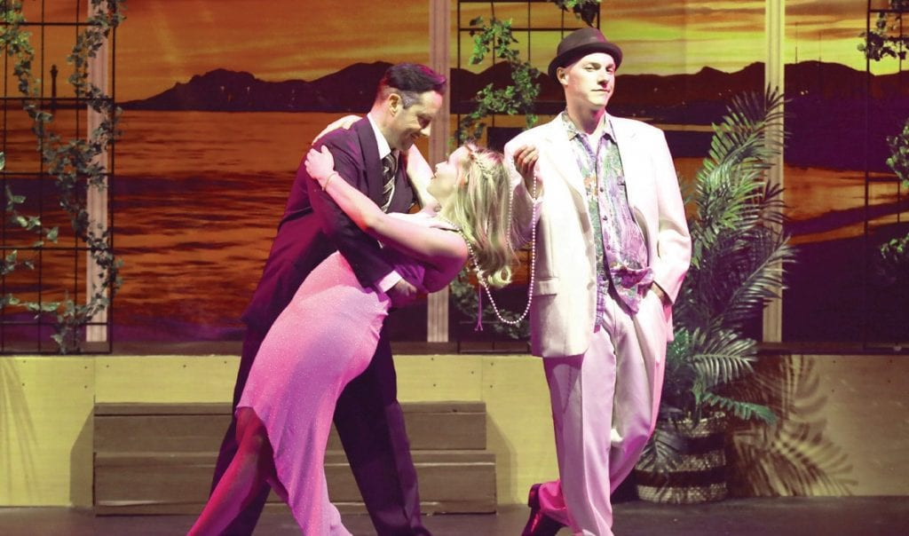 "THE HUNT IS ON—From left, Lawrence Jamieson (Nick Newkirk) attempts to seduce Christine Colgate (Megan Rayzor) while Freddy Benson (Michael Rosenblum) waits in 'Dirty Rotten Scoundrels."" Courtesy of Barbara Mazeika"