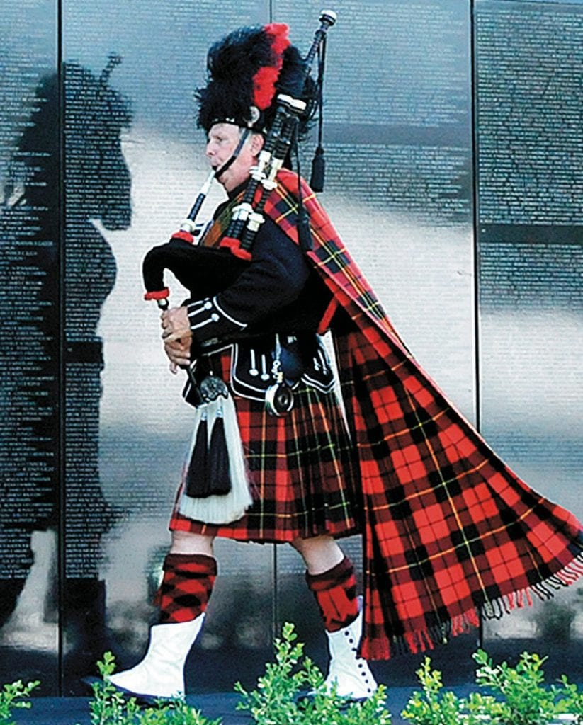 COLORFUL TRIBUTE—A bagpipe player signals the arrival of the traveling Vietnam Wall that came to Westlake Village in 2009. Acornfile photo