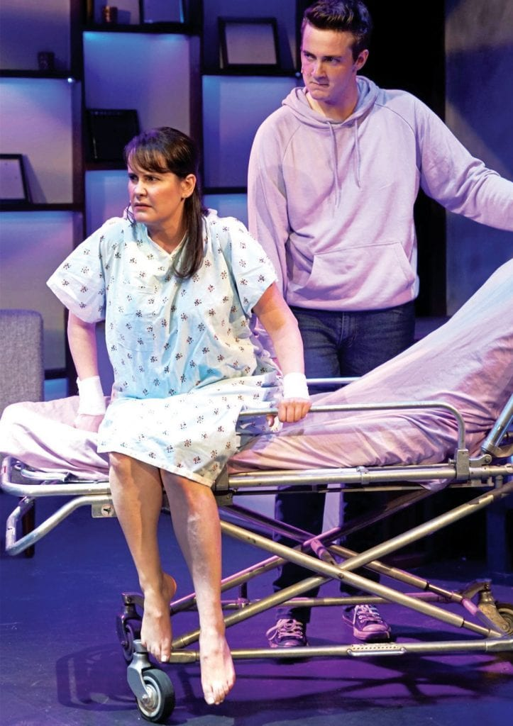 """THERAPY—Diana (Michelle Lane) struggles with mental illness as her son, Gabe (Landen Starkman) watches in """"Next to Normal."""" Courtesy of Paul Cranmer"""