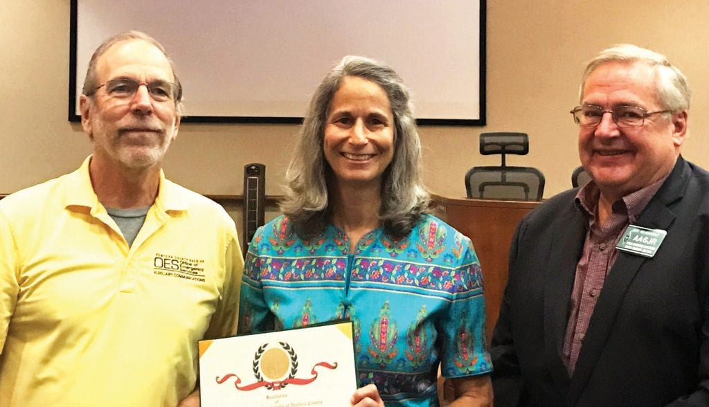 NOW HEAR THIS—Ventura County Supervisor Linda Parks, center, presents a proclamation honoring the region's ham radio operators to Rob Hanson of Newbury Park and Jeff Reinhardt of Agoura Hills. Courtesy photo