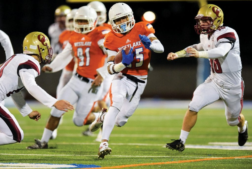 OVER THE HILLS AND FAR AWAY—Daniel Fox, center, runs for Westlake High's football team against rival Oaks Christian on Nov. 6, 2015. Fox is an incoming sophomore cornerback for Cal Poly San Luis Obispo. MICHAEL COONS/Acorn Newspapers