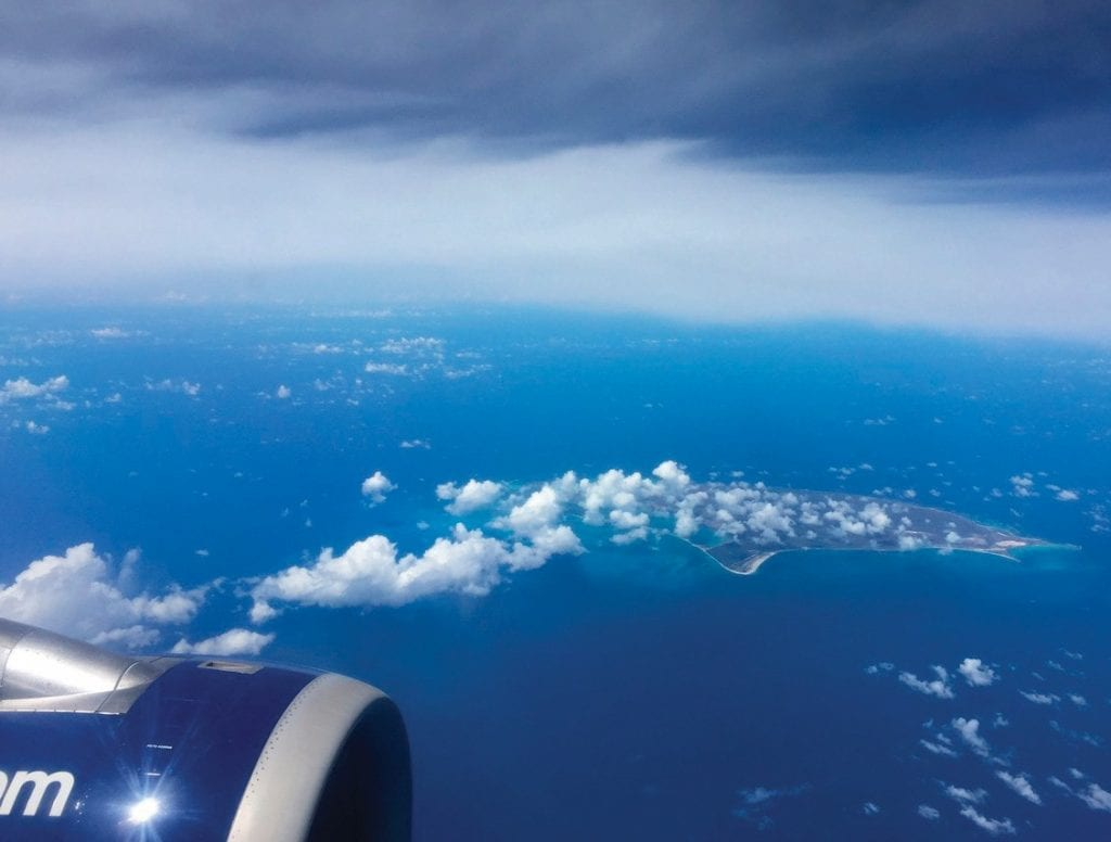 IN FOR THE LONG HAUL—Travelers may need more than the sight of clouds and skies outside the cabin window to keep themselves amused during long boring flights. THOR CHALLGREN/Acorn Newspapers