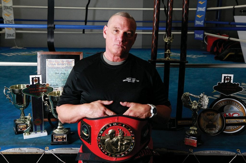 WELCOME TO THE DOJO—Dale Jacoby, 53, with his numerous awards at KO Studios in Agoura Hills, won the sport karate 40-plus age group at the USA World Championships in Las Vegas last month. RICHARD GILLARD/Acorn Newspapers
