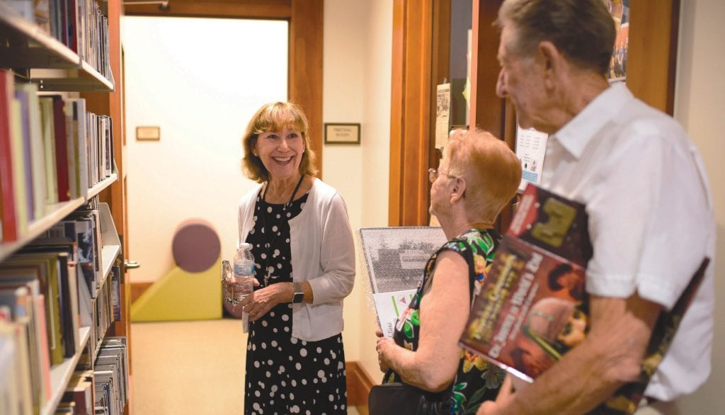 FAMILIAR FACE—Calabasas City Librarian Barbara Lockwood, left, gives a tour of the facility during the library's 20th anniversary celebration July 14. Lockwood has been with the library since it opened in 1998. MICHAEL COONS/Acorn Newspapers