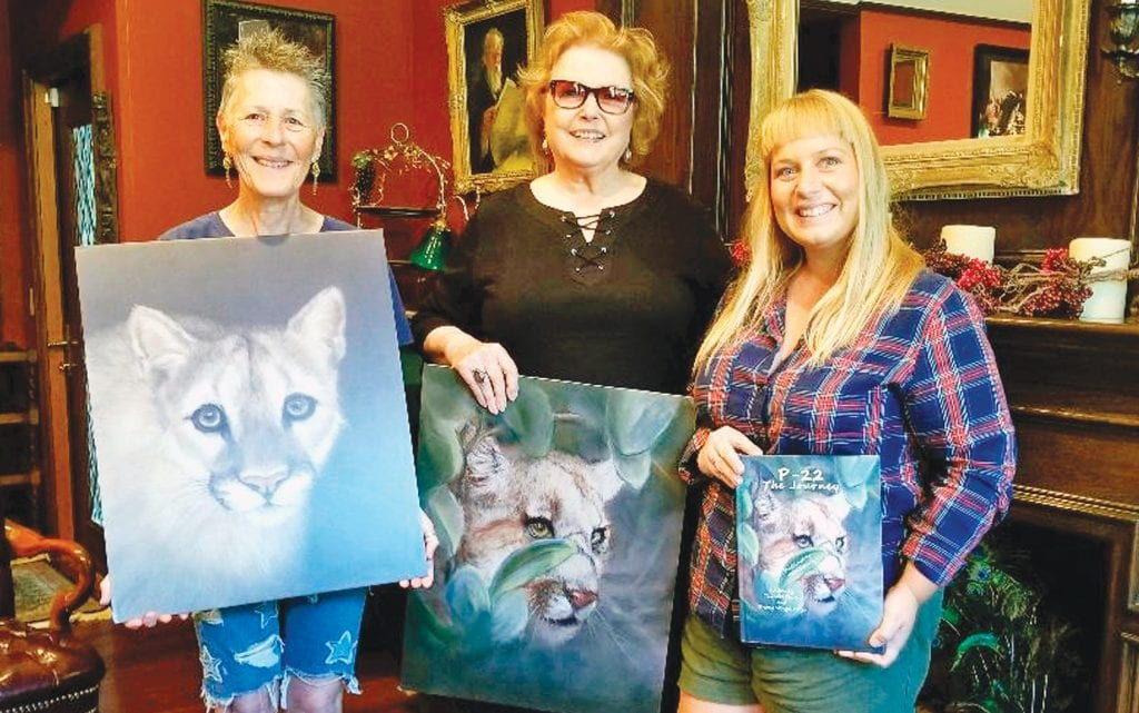 """PUMA PICS—From left, Agoura resident and writer Sherry Mangel-Ferber, Old Agoura artist Kathi Colman and writer Calandra Cherry of Burbank collaborate on a book with narrative and art pieces of cougars, especially P-22. Up to 25 percent from sales of """"P-22: The Journey""""will be donated to #SaveLACougars. STEPHANIE BERTHOLDO/Acorn Newspapers"""
