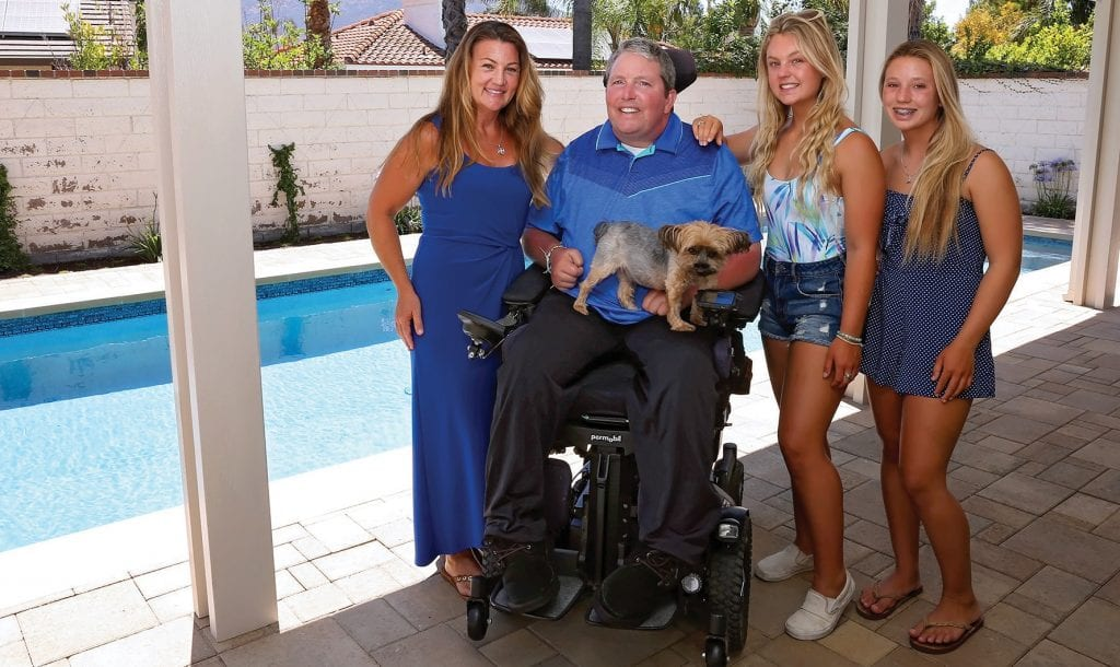 MAKING WAVES—The Windisch family—from left, Kris ta; Chris; Summer, 17, and Grace, 14—show off the newly installed pool at their Agoura Hills home. The pool will allow Chris to pursue physical therapy. DIANNE AVERY/Acorn Newspapers