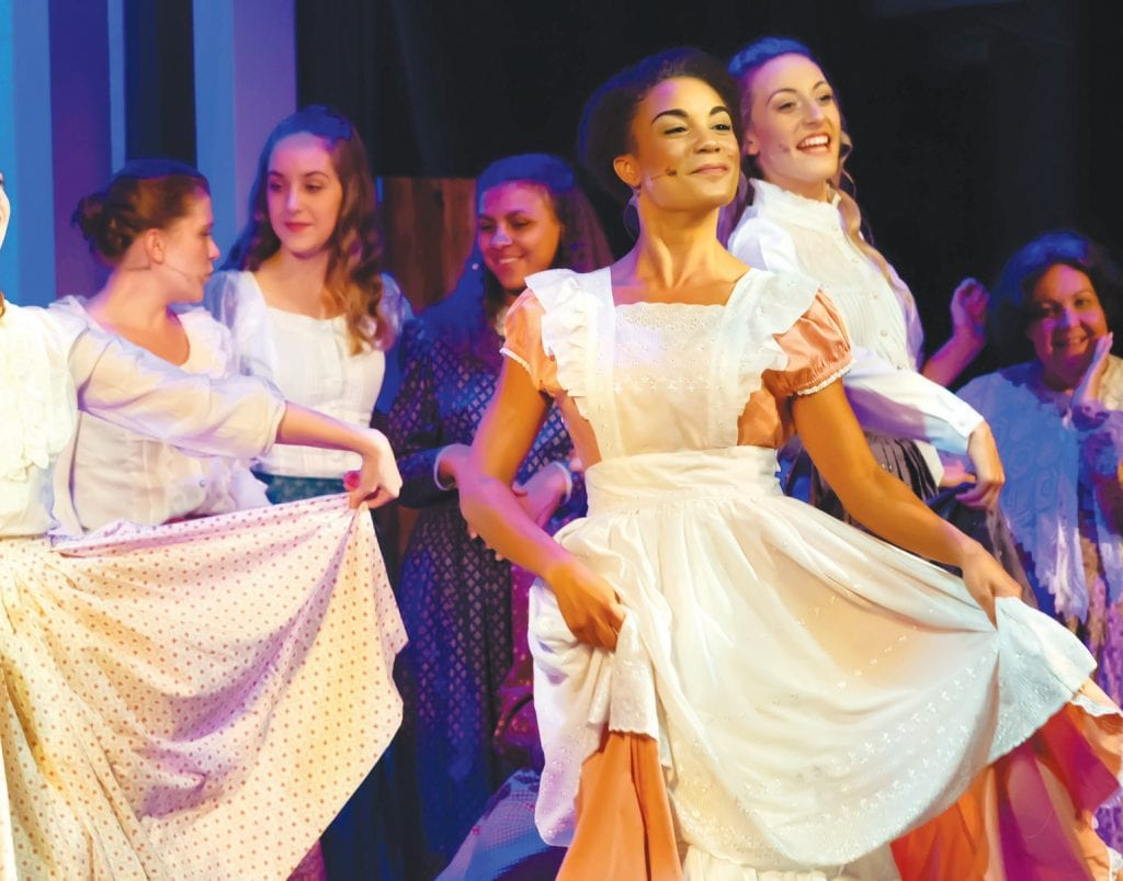 """O WHAT A BEAUTIFUL MORNIN'—Laurey (Sara Owinyo), center, and the farm girls dance to """"Many a New Day"""" in """"Oklahoma!"""" Courtesy of Mike Malavisi"""