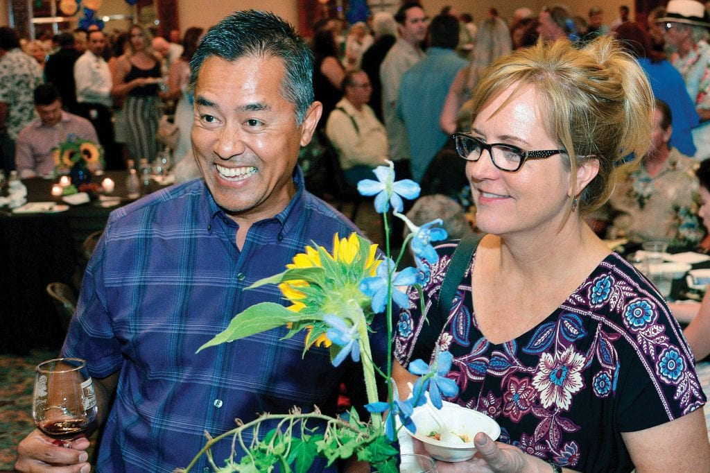 FOOD AND DRINK—Zin and Christi Htway of Thousand Oaks sample the beverages and food during the 17th annual Midsummer Eve Wine Festival Aug. 11 at the Hyatt Regency Westlake. The Thousand Oaks Rotary Foundation sponsored the event that benefits the Ventura County Special Olympics program. The evening included a silent auction and guest speakers. Photos by SUSAN WEININGER/Acorn Newspapers