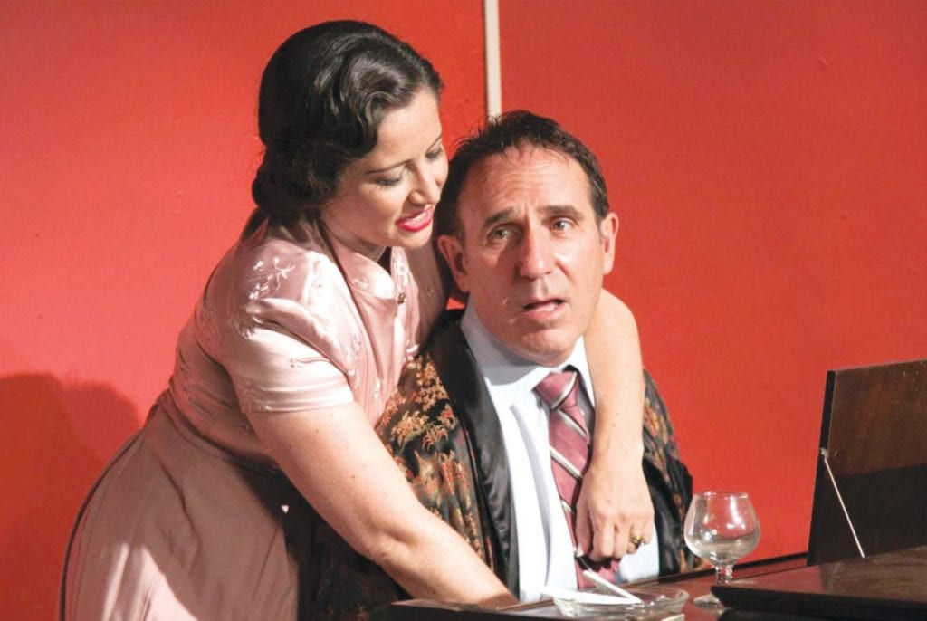 "LOVEBIRDS—Amanda (Genevieve Levin) and Elyot (Alan Waserman) take a tender break betweenfights in Noel Coward's ""Private Lives."" Courtesy of Pamela Newman"