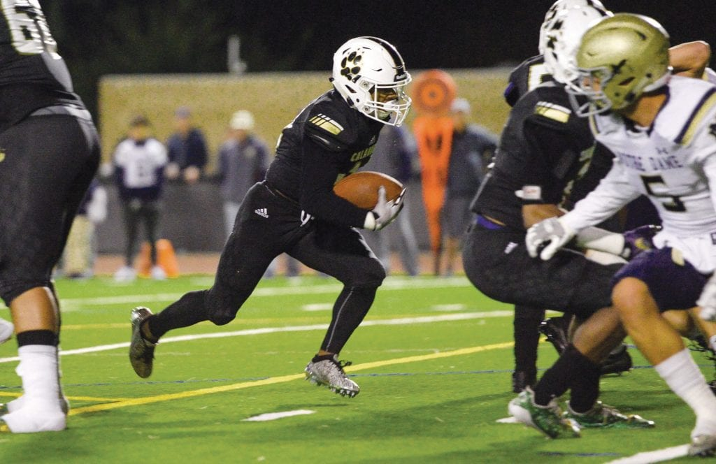 END ZONE FEVER—Calabasas High football running back/receiver Julien Stokes runs the ball up the middle for a touchdown against Notre Dame last season in the playoffs. Stokes is a sophomore. MICHAEL COONS/Acorn Newspapers