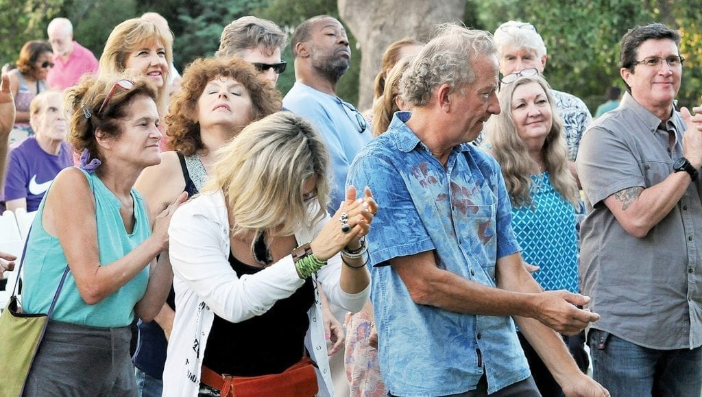 ON THEIR FEET— Music lovers steel themselves in front of the stage for more great hits during the community concert Aug. 26 at Calabasas Lake.