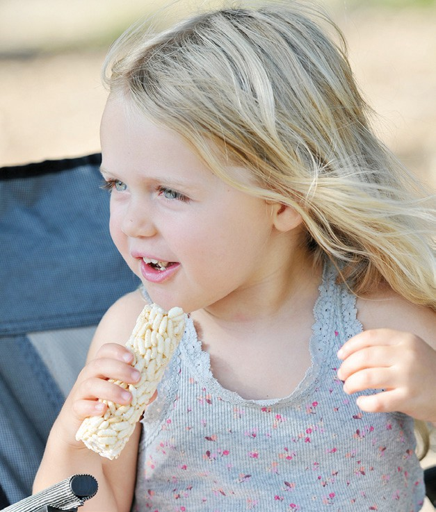 SWEET TREAT— Woodland Hills resident Ella Durocher, 3, satisfies her munchies during the Steely Jam tribute show last Sunday.
