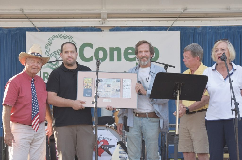GOOD ENOUGH—Above, The Conejo Recreation and Park District honors Thousand Oaks Acorn editor Kyle Jorrey, second from left, and Acorn Newspapers owner Jim Rule, middle, before thefinal show in the 2018 Summer Concerts in the Park series at Conejo Community Park on Sept. 3. With them are CRPD board members, from left, George Lange, Chuck Huffer and chairperson Susan Holt. At left, Ozzie Mancinelli, left, and John McAllister of The Pettybreakers show the crowd were it's at during the early evening concert. Bottom left, 20-month-old Pearl Hise and her mother, Marci, both of Newbury Park, dance to the tunes of the Tom Petty and the Heartbreakers tribute band.
