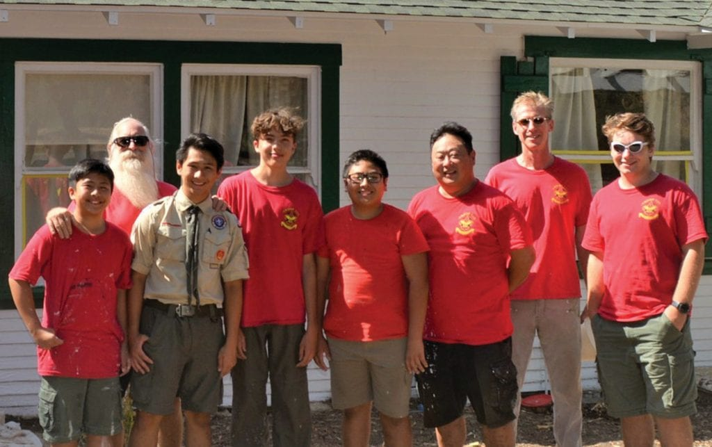 PRESERVING HISTORY—Eagle Scout candidate Charlson Lee, third from left, and Boy Scout Troop 127 complete a restoration and outdoor clean-up of areas surrounding the Masson House, Calabasas Historic Landmark No. 1, built in the early 1900s. In 2016, a wildfire swept through Calabasas and damaged Headwaters Corner Park, where the house stands. Charlson's Eagle project was to refurbish and repaint the exterior of the landmark, which also serves as a nature and visitor center. From left are: Chris Lee, headmaster Geoff Gunn, Charlson Lee, John Lietsch, Calvin Lee, Charles Lee, Steve Lloyd and Ali Sarman. Courtesy photo