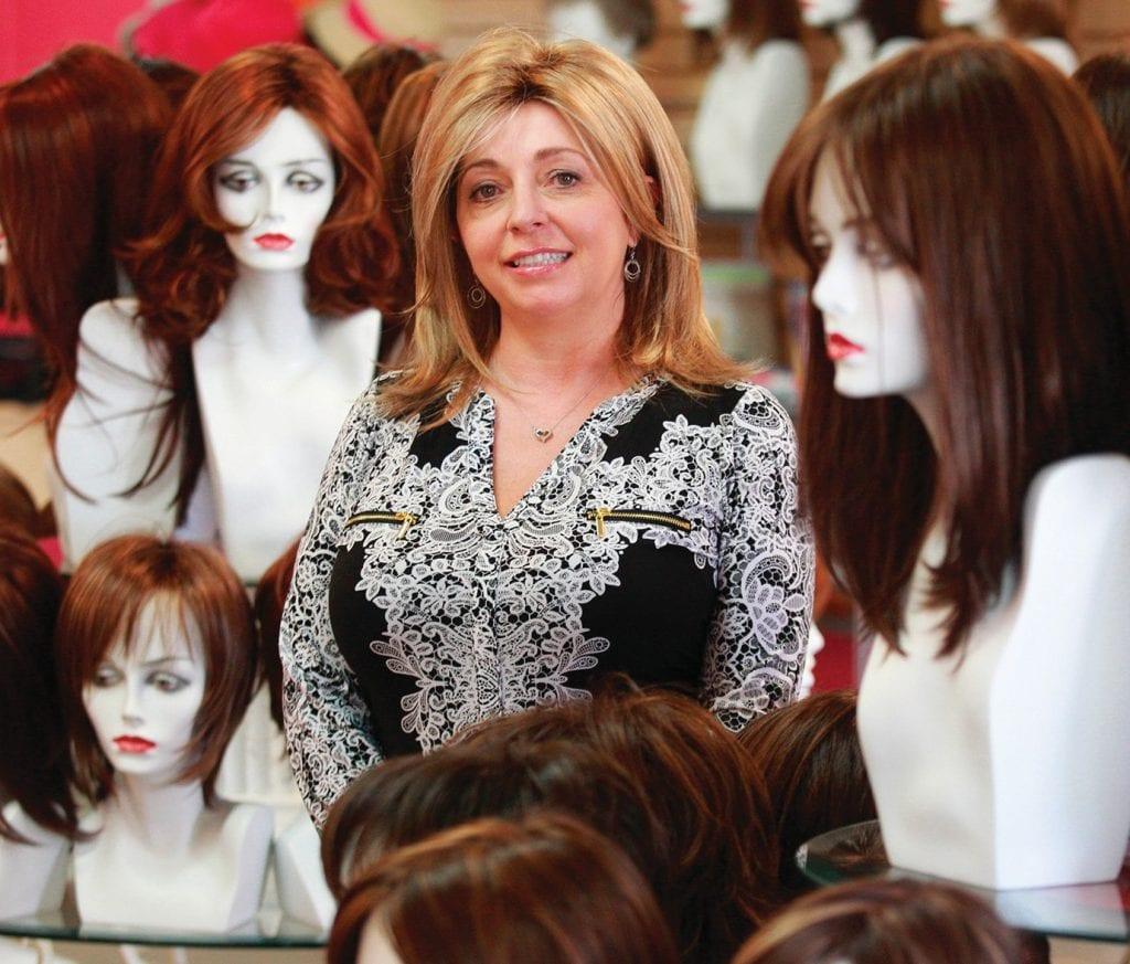 "COIFFURES FOR CANCER—Donna Herbert runs Godiva's Secret Wigs, a Thousand Oaks shop that helps women look their best when their locks begin to dwindle. ""Donna is an angel,"" one customer says. RICHARD GILLARD/Acorn Newspapers"