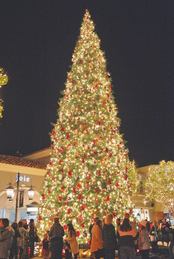 LIGHT 'ER UP!— The mall's 65-foot Christmas tree shines brightly following the ceremonial lighting. Below, drummers take the stage as part of the festivities. Event organizers also gave a big thank you the first responders who helpedfight the Woolseyfire.