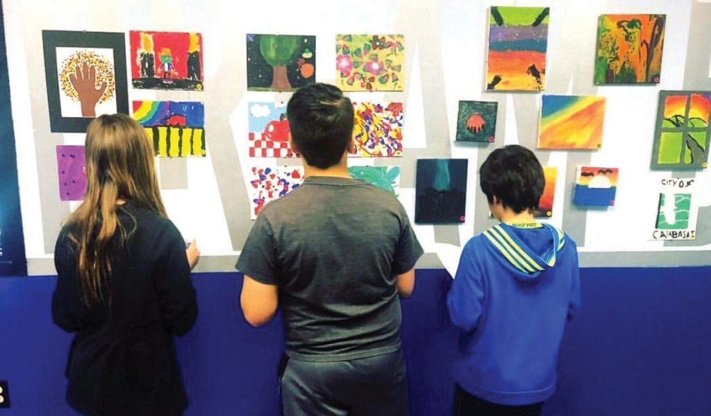 BURST OF COLOR—Members of the Boys & Girls Clubs of Greater Conejo Valley have their artwork on display for the public to view at the youth center on the campus of Los Cerritos Middle School in T.O. Courtesy photo
