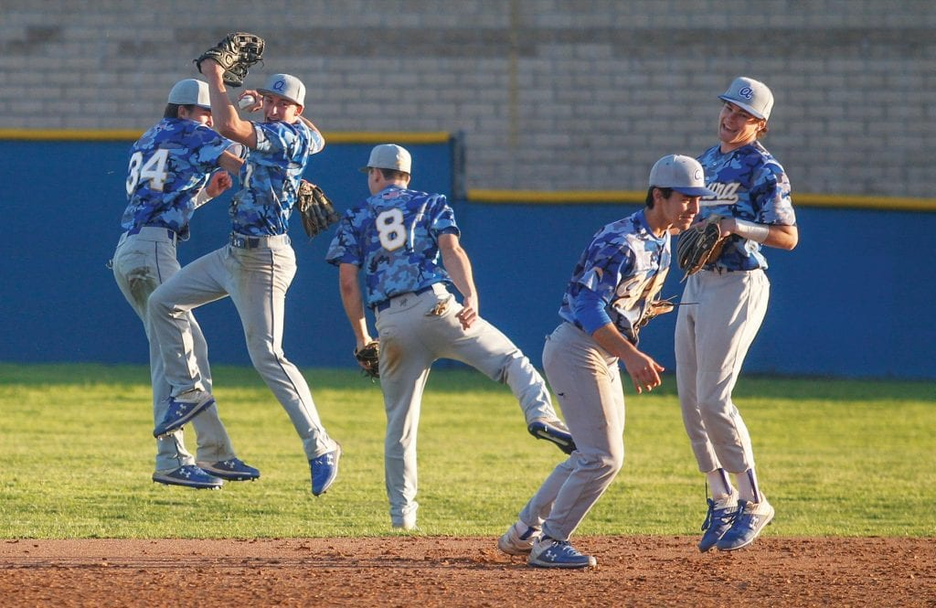 TURN IT UP LOUD—Agoura High baseball players celebrate an 8-5 win against Camarillo on March 8 on the road. The Chargers won theirfirstfive Coastal Canyon League games, theirfirst in the new league. Photos by RICHARD GILLARD/Acorn Newspapers