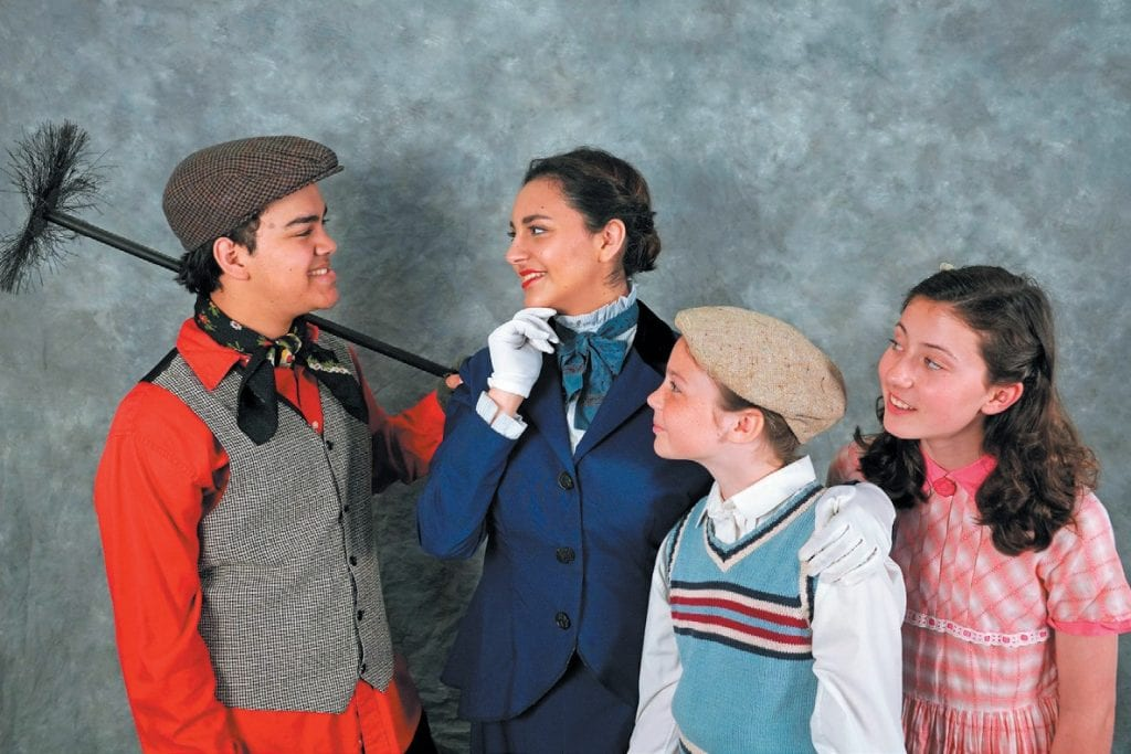 NANNY MAGIC—Bert (Jassir Rivera), left, and Mary Poppins (Margaret LeFleur) teach the Banks kids, right, in the YAE play. Courtesy of Paul Cranmer