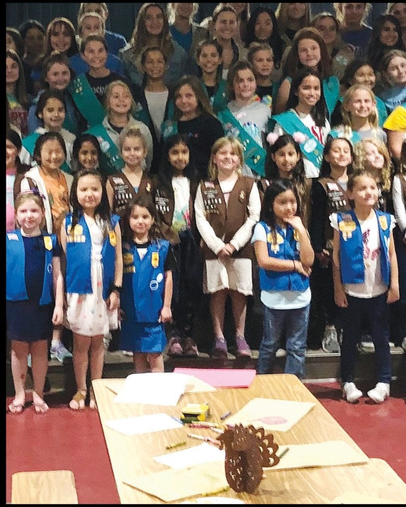 THANKFUL—Girl Scouts from Service Unit 606, along with parents and Scout leaders, gather to celebrate Friendsgiving Nov. 6. The girls made care packages for delivery to American troops overseas Courtesy photo
