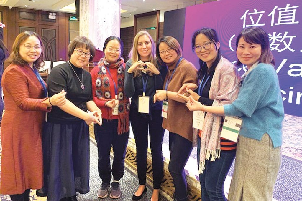 HEARTS IN CHINA—Iris Van Dyke, center and inset right, with some of the conference participants from different provinces in China during her recent teaching trip.