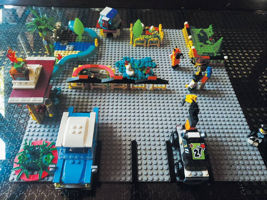 ZOO TIME—Here's a clever zoo for Lego characters: It's for when they are free from being played with and offers a place for them to relax and look and pet the animals. Created by Ryli Allen