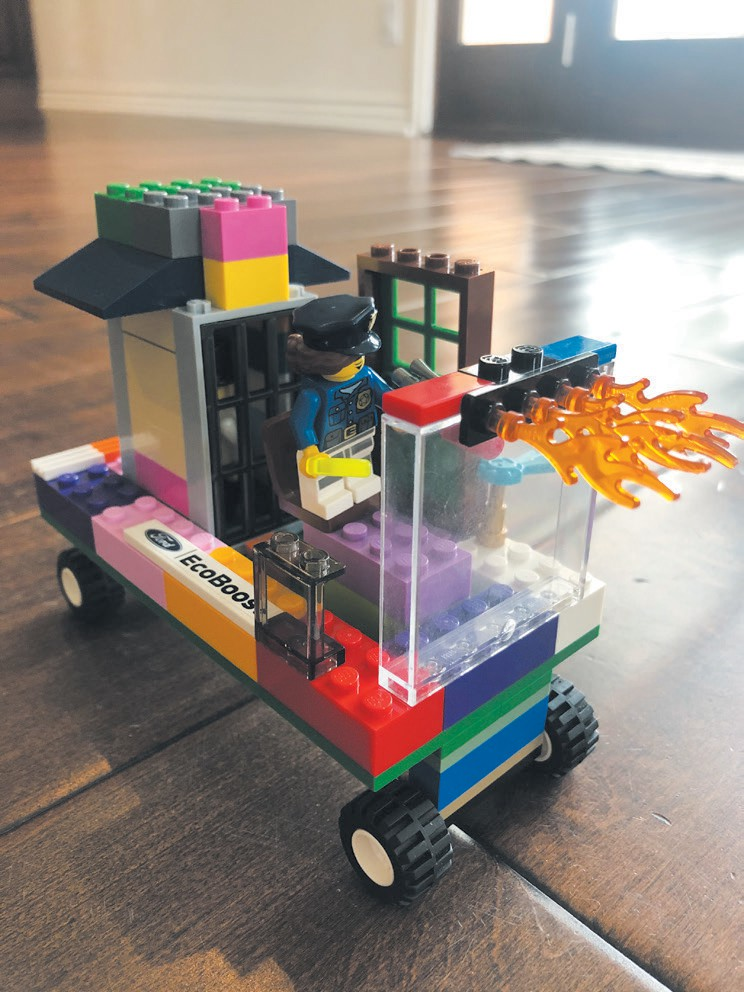 READY FOR ACTION—Little Mason builds a police car with a jail on it. Created by Mason Robichaud, age 5