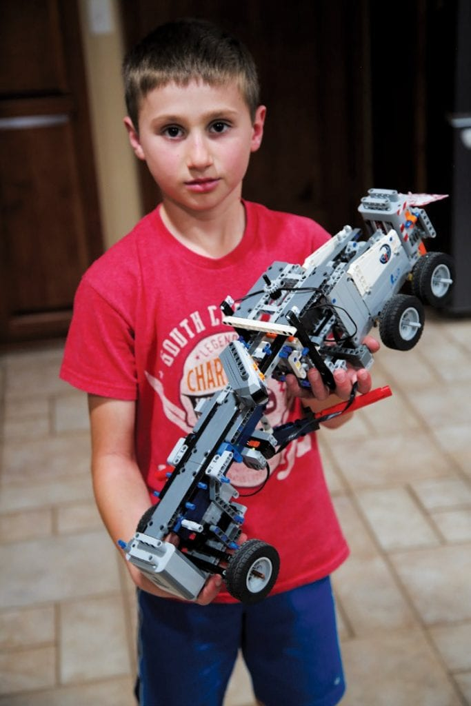 TOP GRADE—Greyson's road grader is remote controlled and all his design and construction. Created by Greyson Tapie
