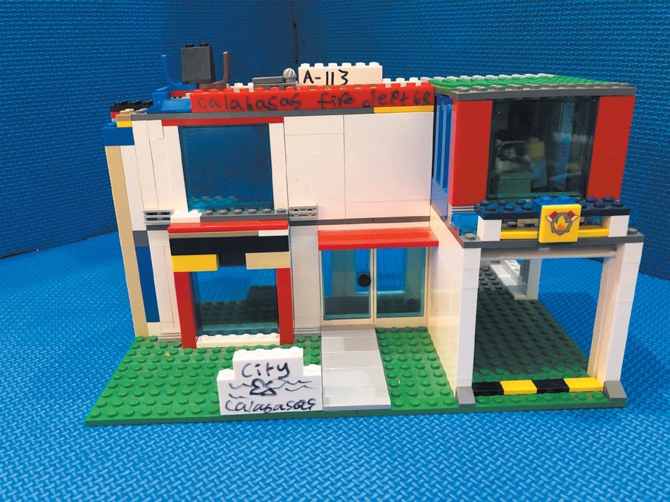 HOSPITAL/FIRE STATION—This comes with a waiting room, doctors offices and a garage for the fire truck. Created by Grant Slatoff