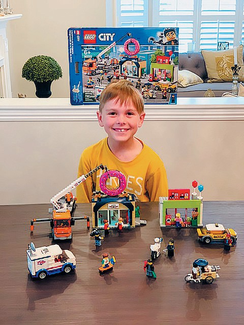 "HAPPY BUILDER—Noah says his grandma and grandpa gave him a City Lego set and that he did this creation in just 2 hours. ""I love building and playing with Legos so much!"" he said. Created by Noah Iwanoff, age 7"