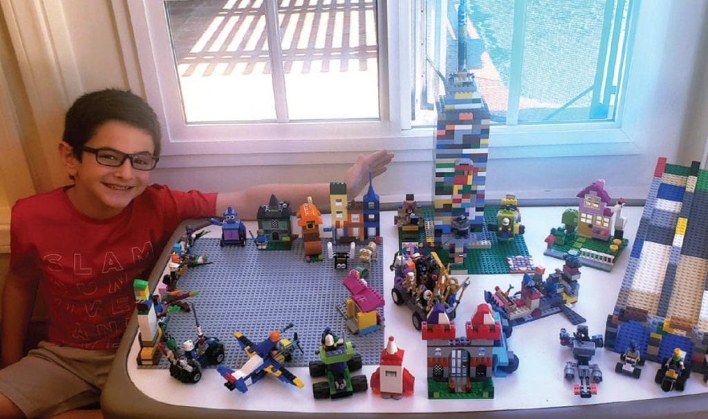 MORE, MORE, MORE—Evan wanted to try to create a building similar to the Washington Monument. He ended up constructing a whole city, including a race track, animals and communities. He is so proud of his accomplishment. Created by Evan Gorowitz