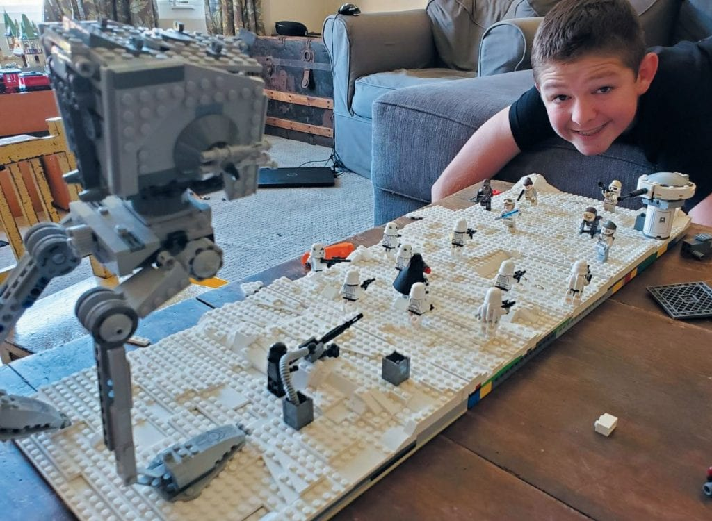 STAR WARS BATTLEGROUND—Brett admires his mockbattle of Star Wars from the planet Hoth. Created by Brett Dato