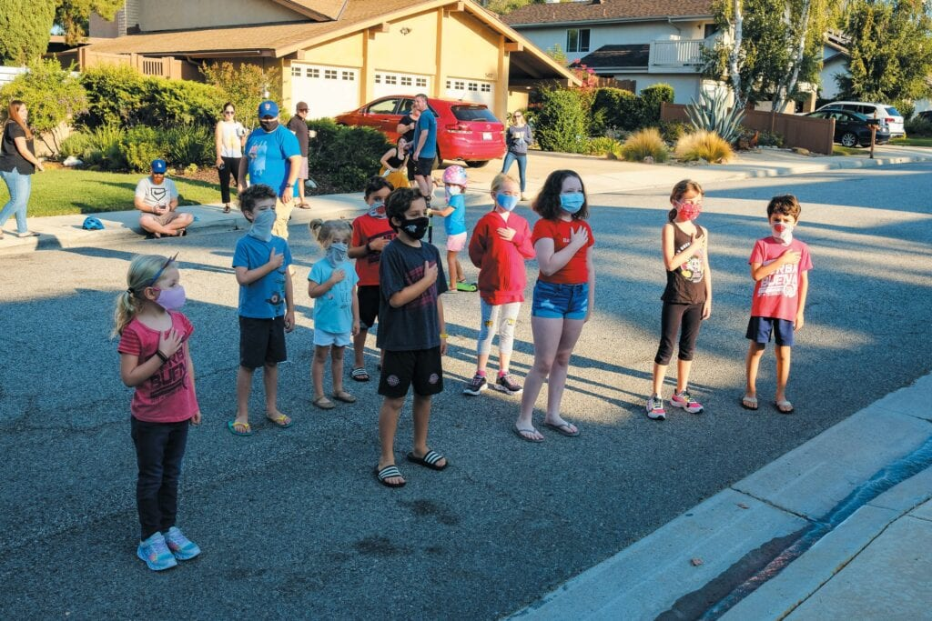 'I PLEDGE ALLEGIANCE'—Children gather Aug. 28 on Cedarhaven Drive in Agoura Hills to say the Pledge of Allegiance before their virtual classes begin. Almost a dozen kids and parents take part in the neighborhood's new morning tradition MICHAEL COONS/Acorn Newspapers