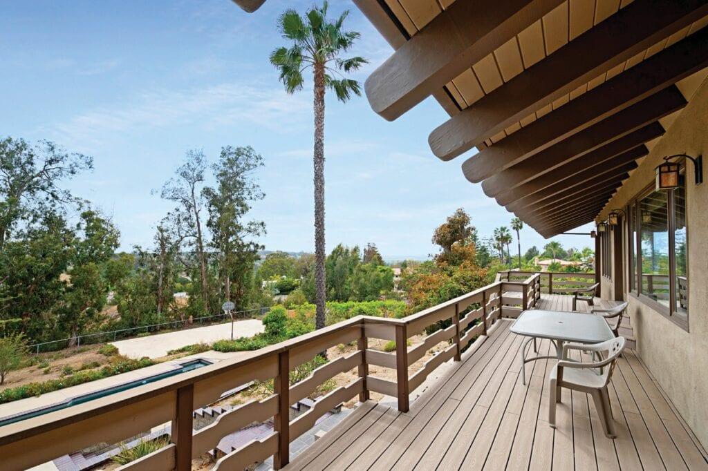 Custom craftsman home has pool, half-size court