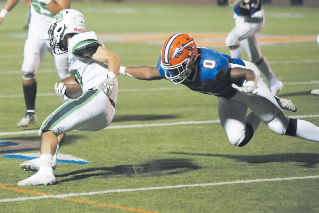 WILD LIFE—Westlake's Gil'Laan Jackson, right, dives for the tackle during the Warriors' 10-7 loss to Thousand Oaks on Aug. 20 at home. Westlake faces Crespi this week. RICHARD GILLARD/Acorn Newspapers